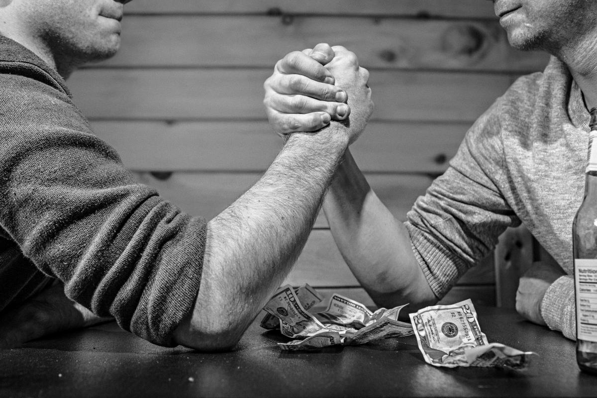 arm wrestling money bills