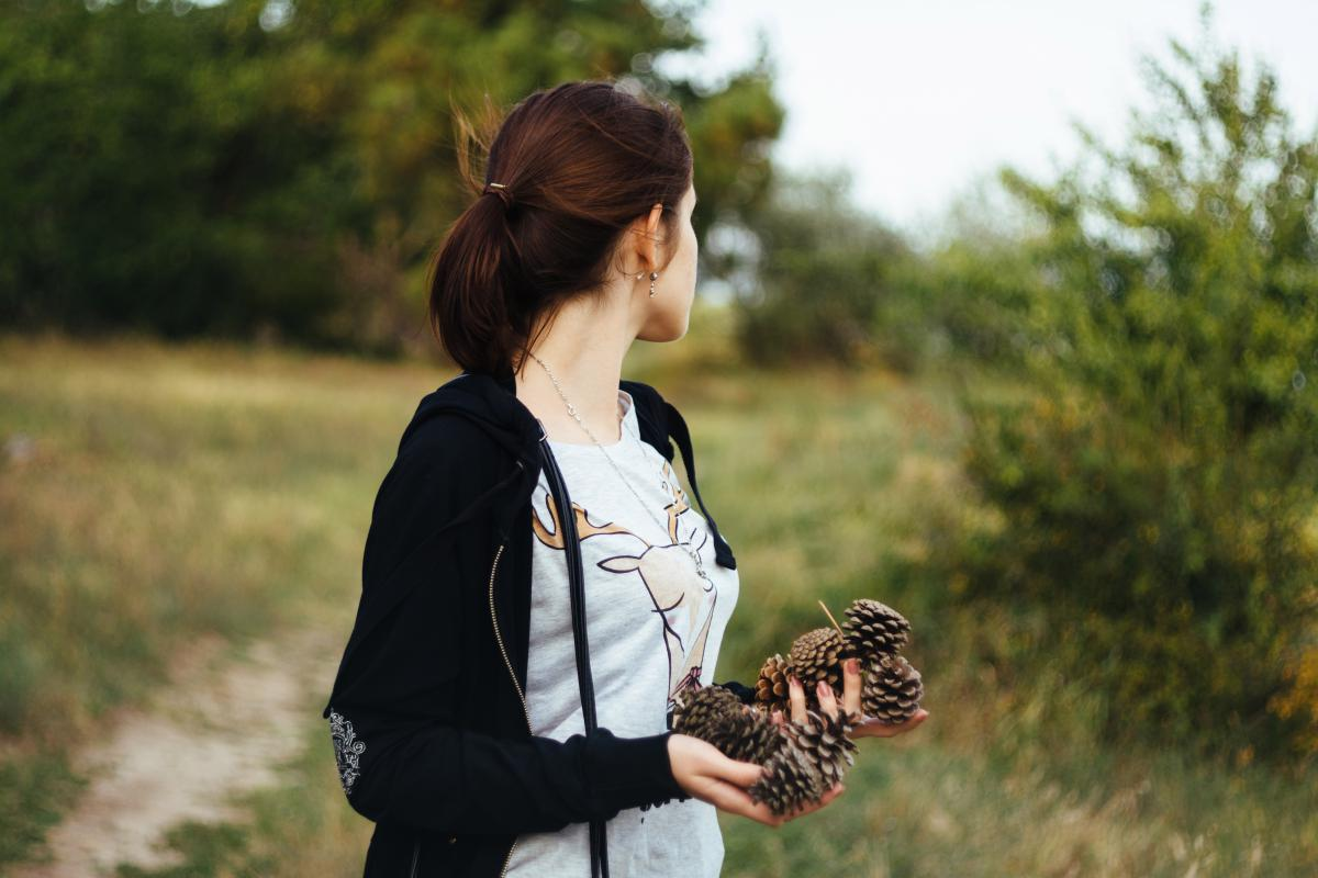 girl woman pine cones