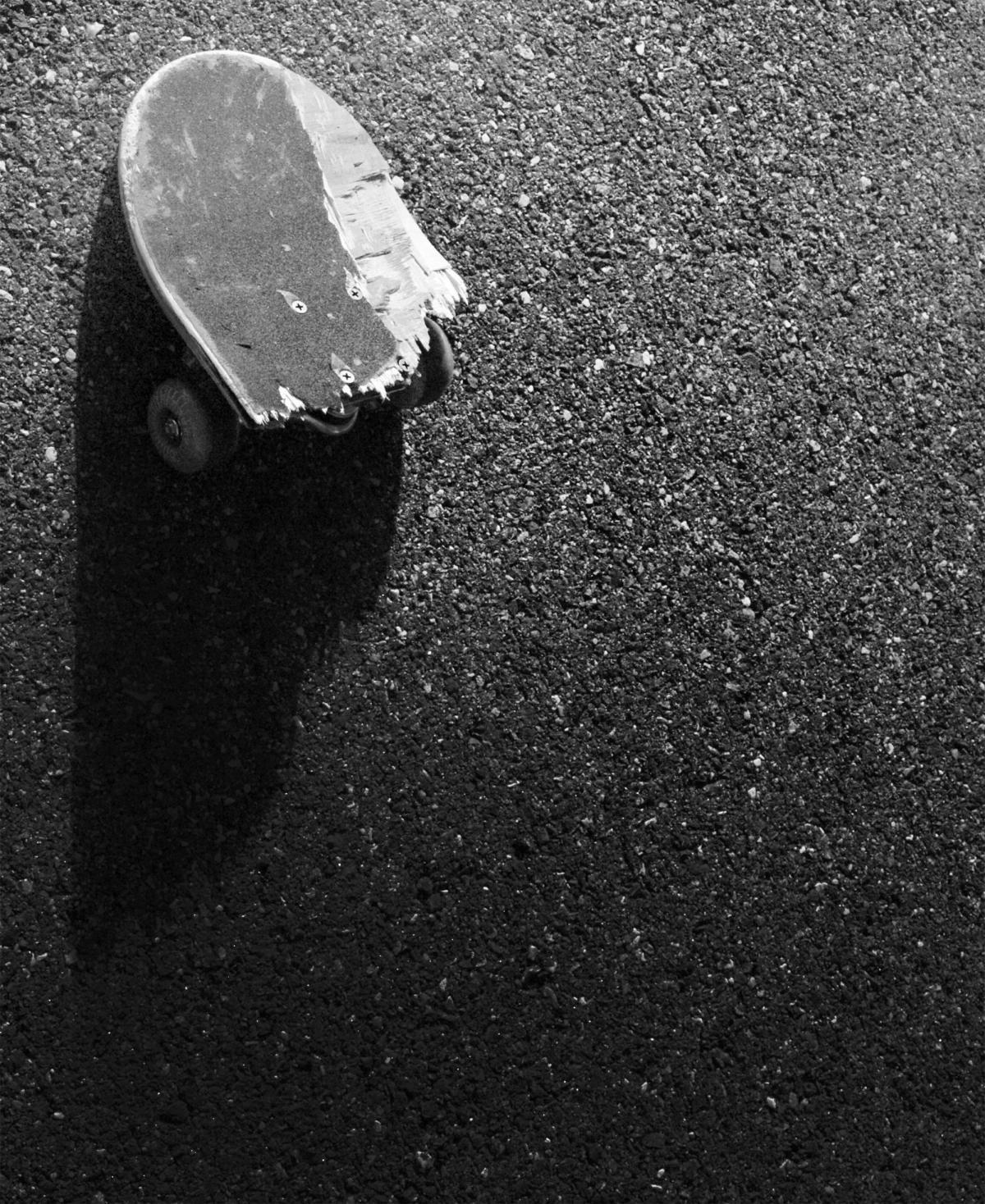 broken skateboard pavement