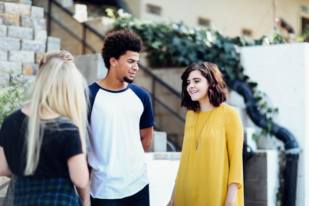 Woman in Yellow Long Sleeved Dress Standing Beside Man in White Blue Crew Neck T Shirt #32038