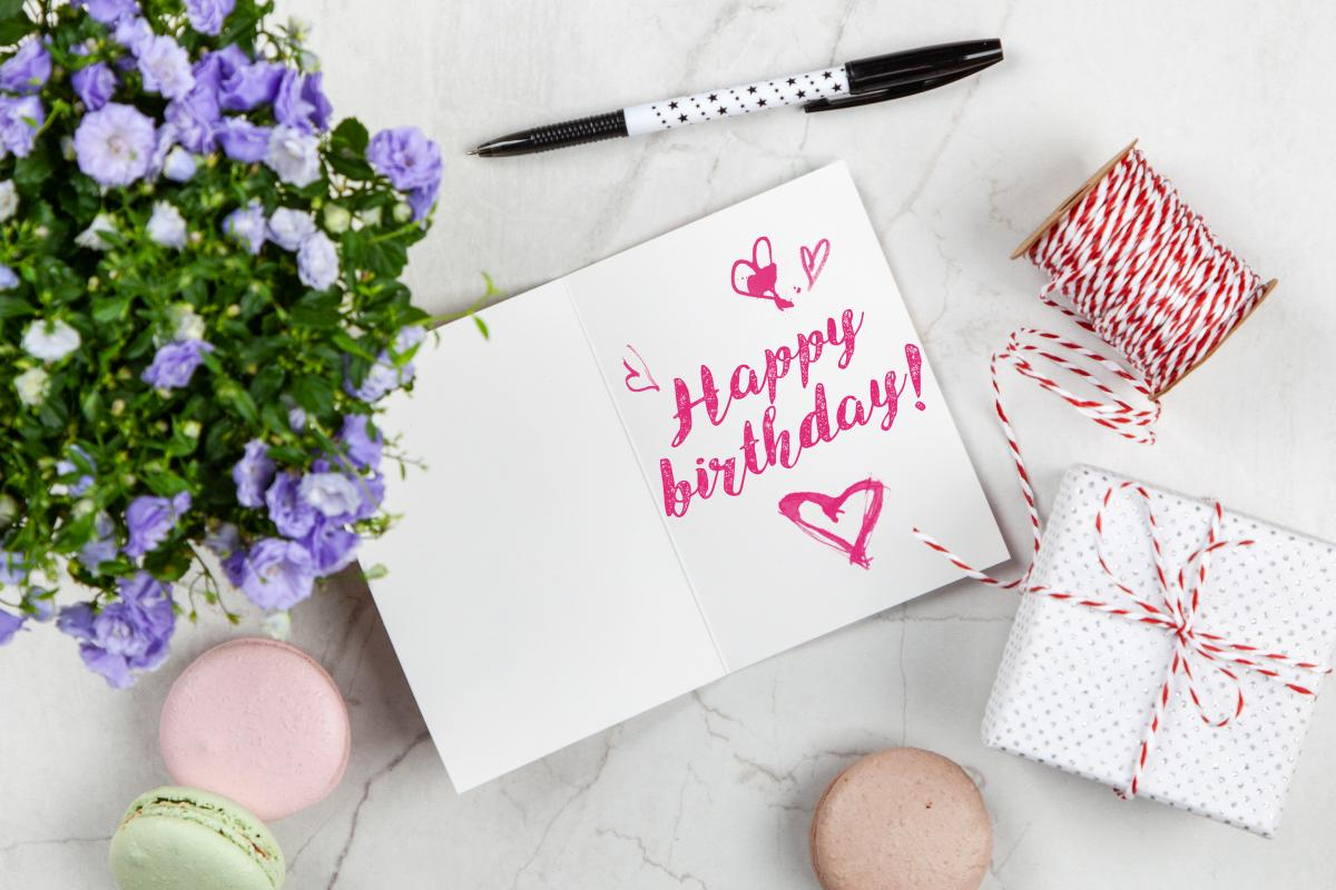 Happy Birthday Card Beside Flower, Thread, Box, and Macaroons