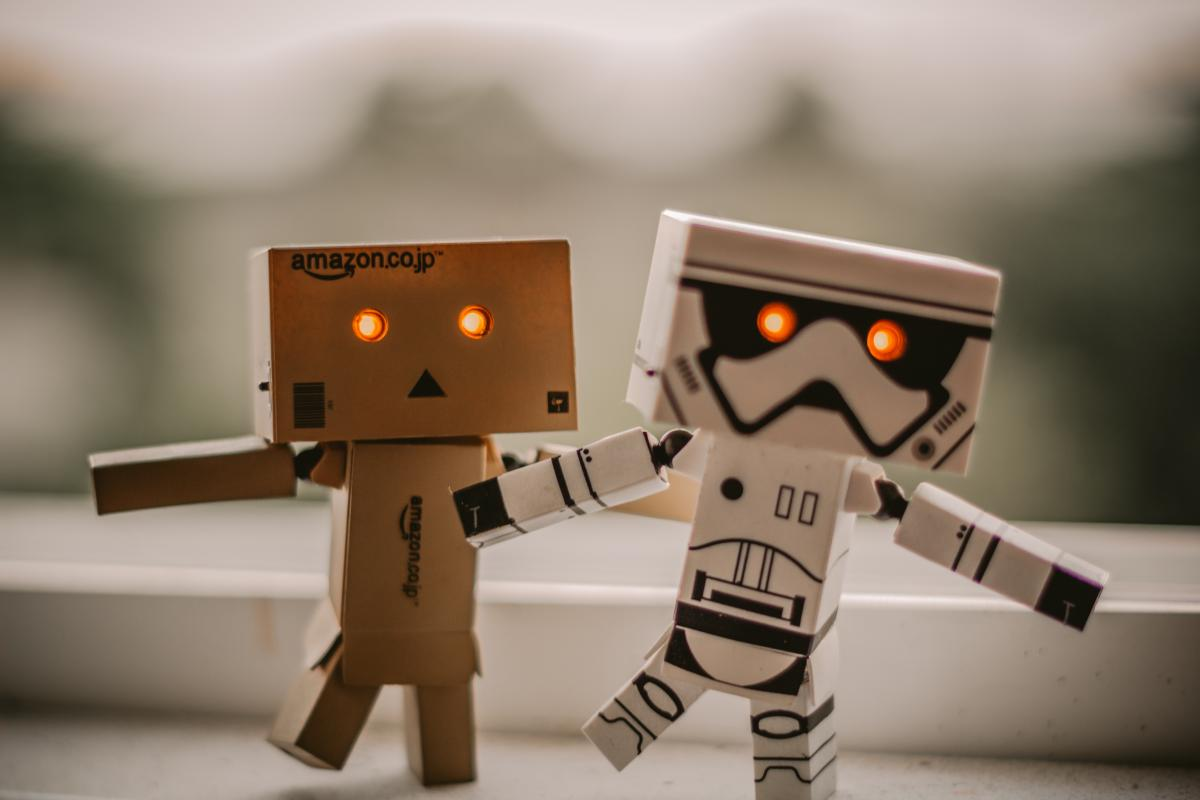 Selective Focus Photography of Two Danbo and Star Wars Stormtrooper Robot Toys