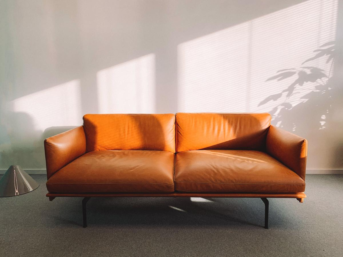 2-seat Orange Leather Sofa Beside Wall #329516