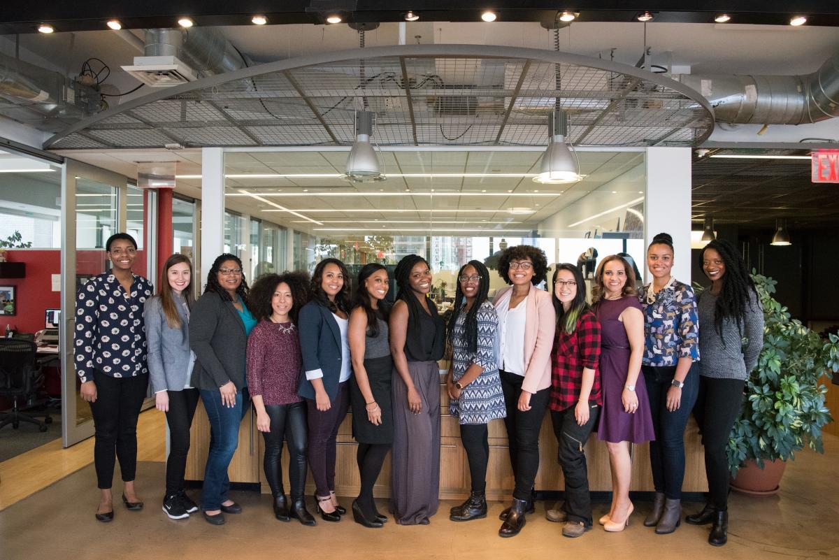 Group of Women Standing Near Desk