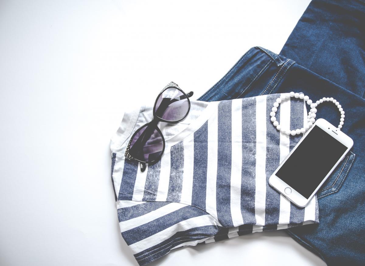 Photo of Iphone on Shirt Near Sunglasses #333523