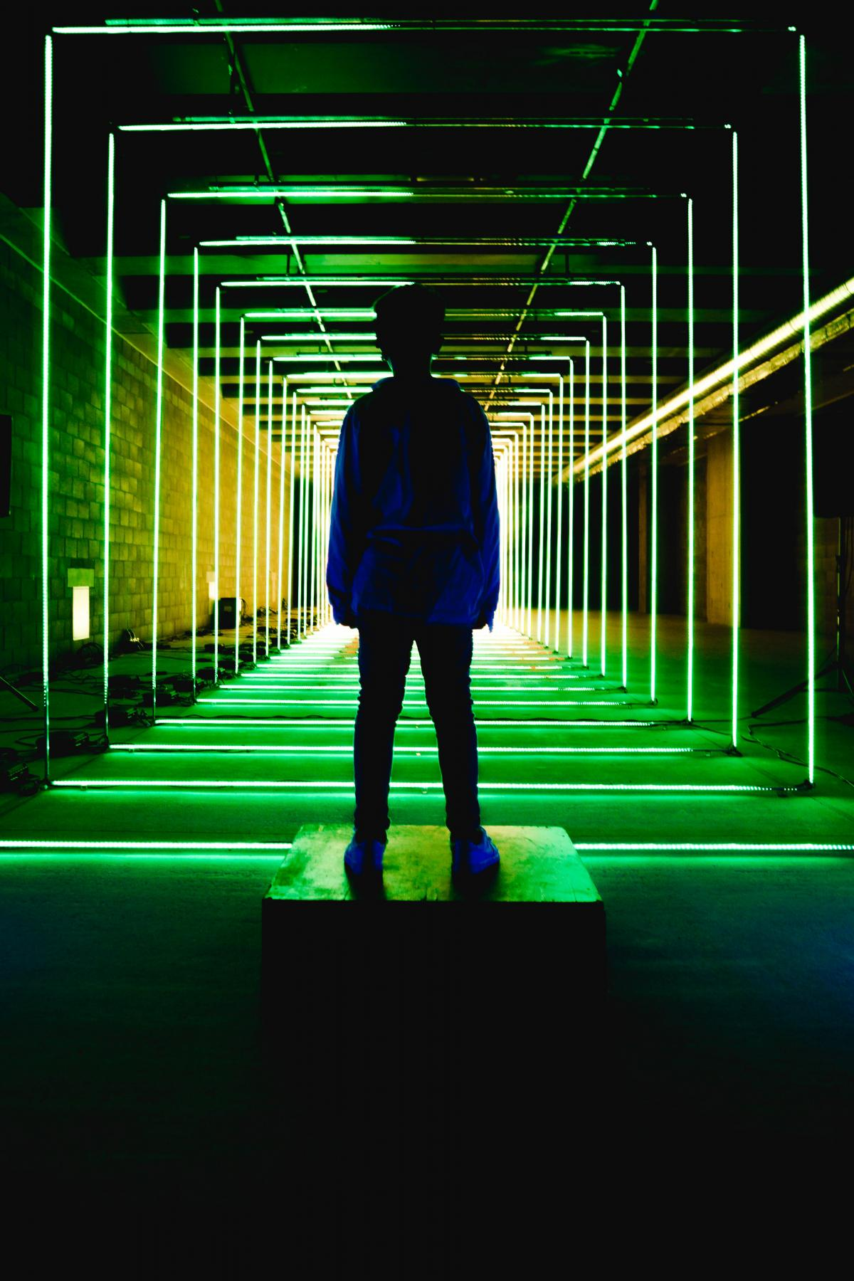 Silhouette Photo of Person Standing in Neon Lit Hallway #339642