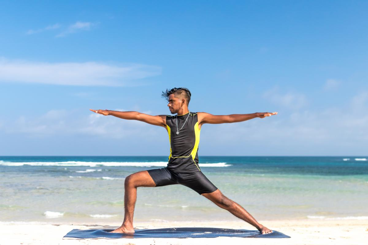 Man in Sleeveless Wet Suit Doing Some Aerobics at the Beach #342141
