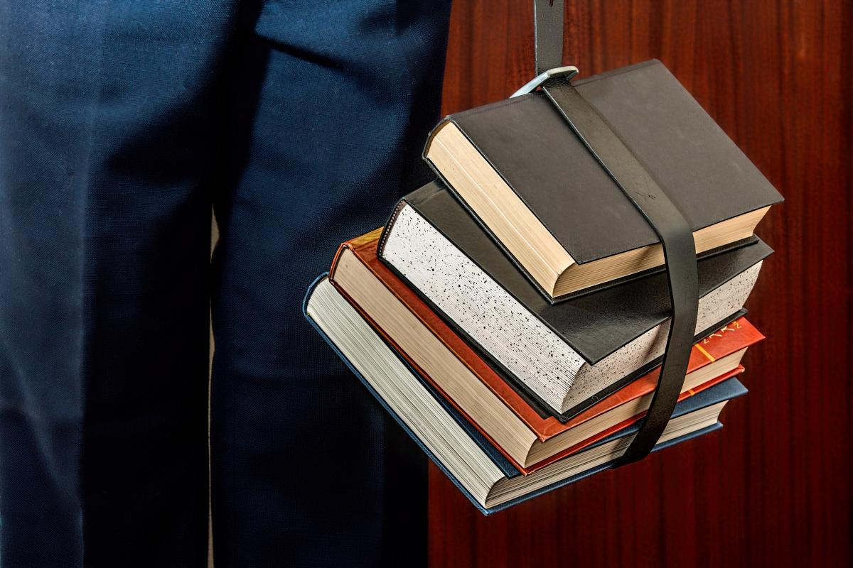 Black Leather Book Strapped Around Four Books #34264