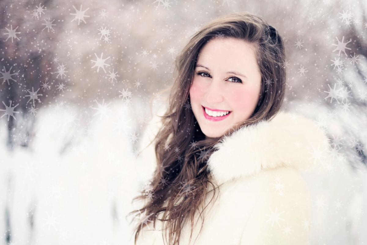 free woman in white furred jacket smiling in front 34362 stock