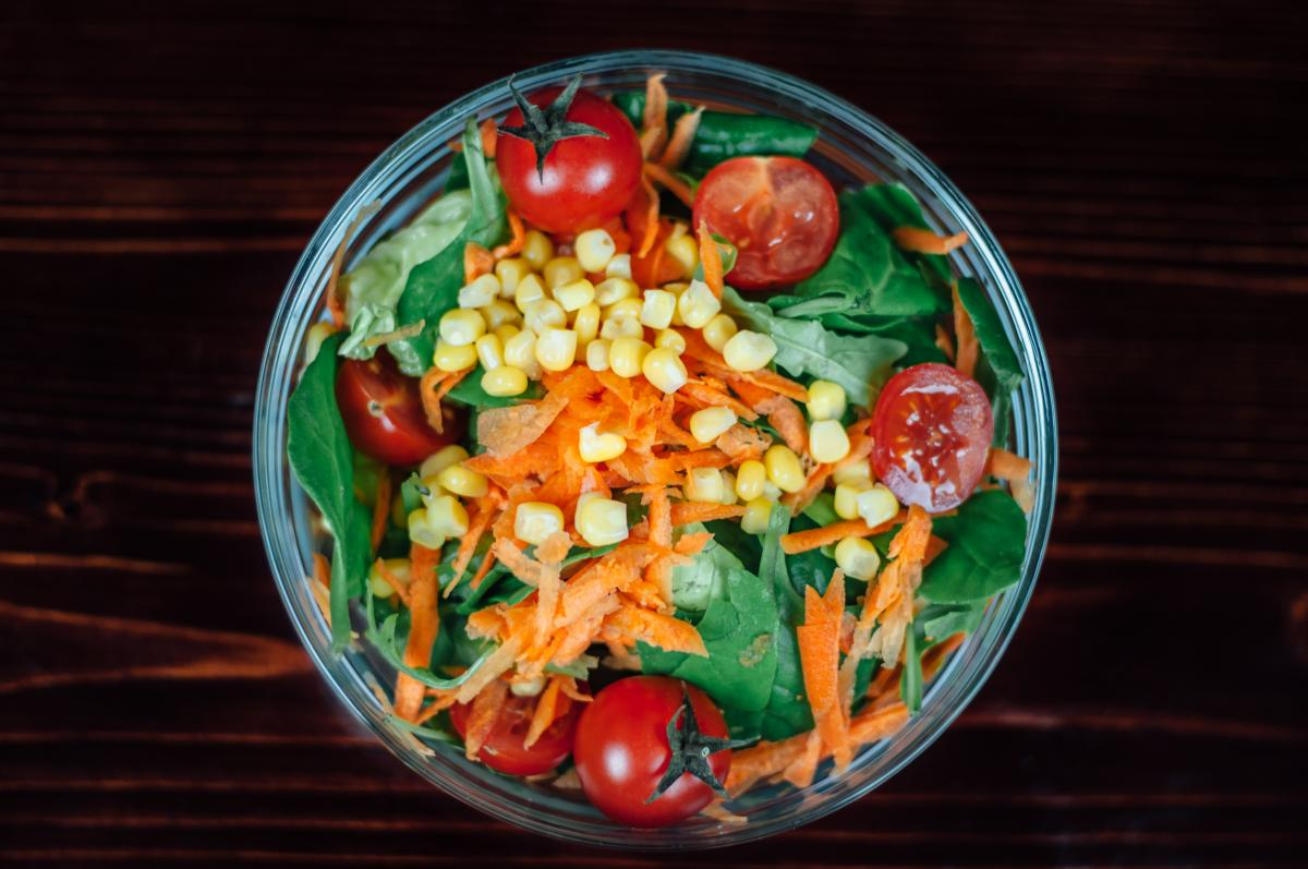Tomato Carrots Corn Salad on Clear Glass Round Bowl