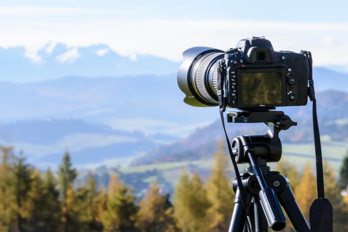 Black Dslr Camera Mounted on Black Tripod #34822
