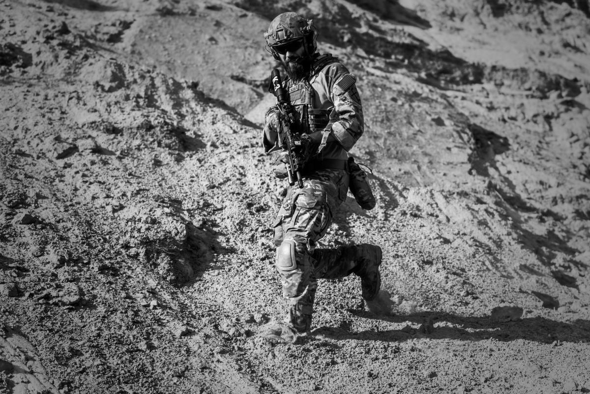 free man in army full combat uniform carrying rifle 37249