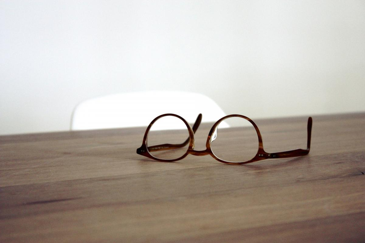 Brown Framed Glasses on a Wood Table