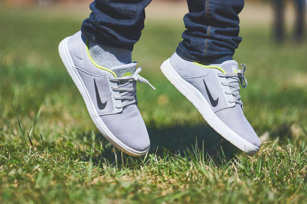 Person Wearing Grey and White Nike Sneaker #37396