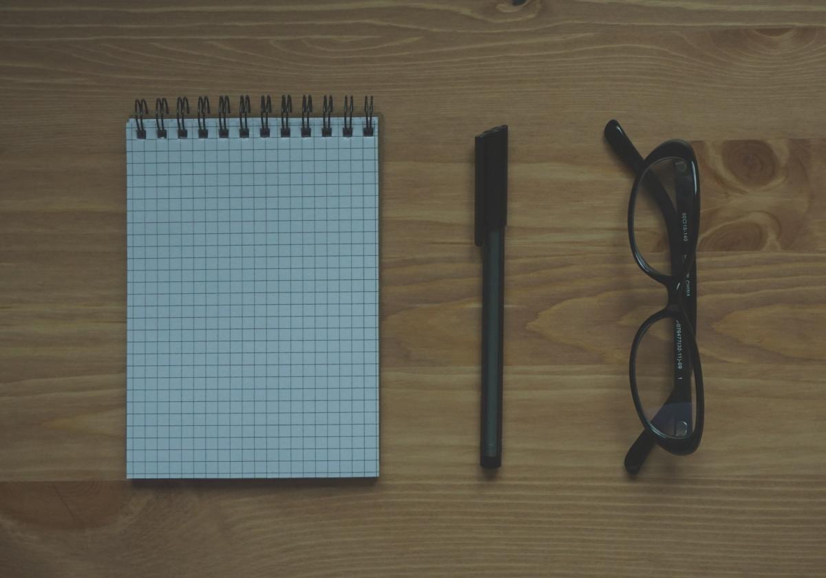 dec45c6775 Free Black Framed Eyeglasses Near Graphing Paper Spiral Notebook ...
