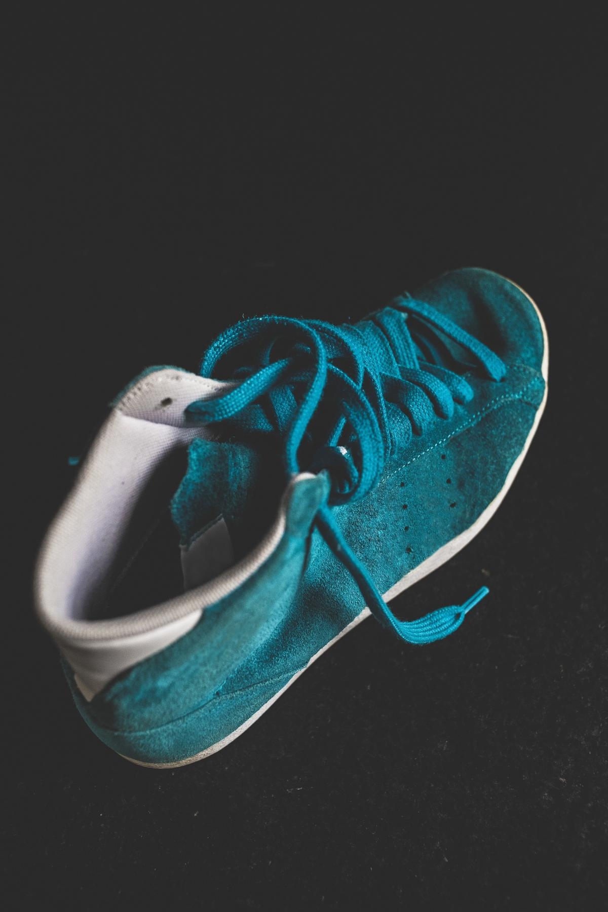 Closeup of a blue suede sneaker