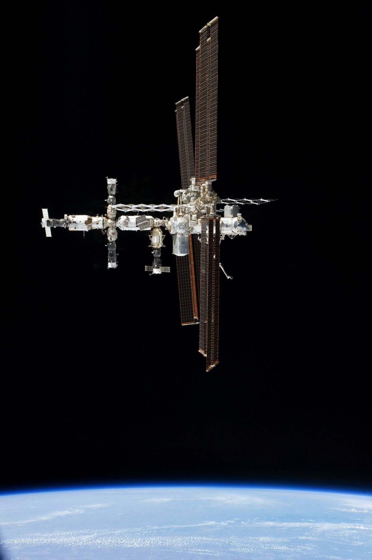 This picture of the International Space Station was photographed from the space shuttle Atlantis in the early hours of July 19, 2011. Original from NASA.  #392646