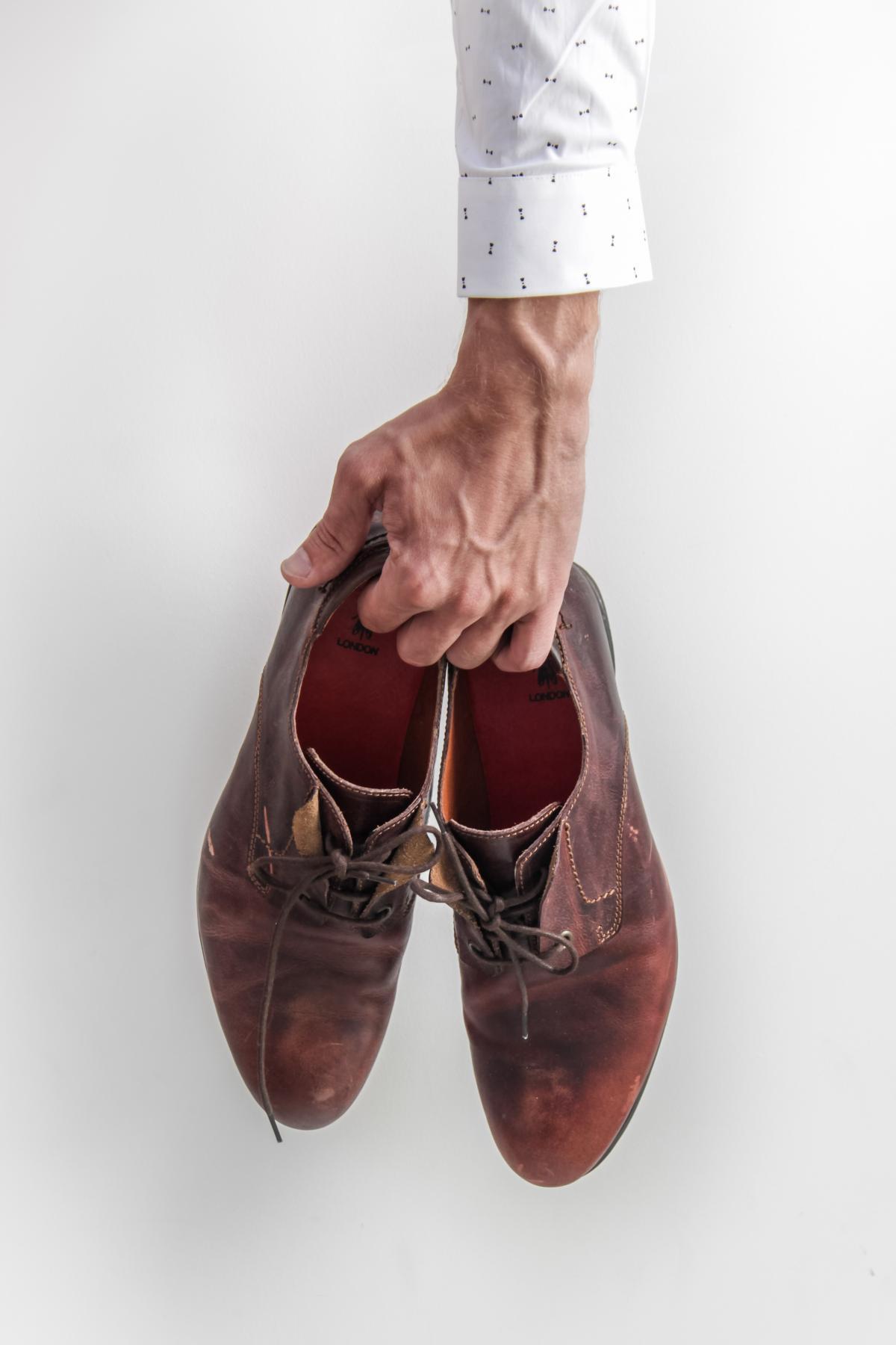 Man Holding Shoes Free Photo #401424