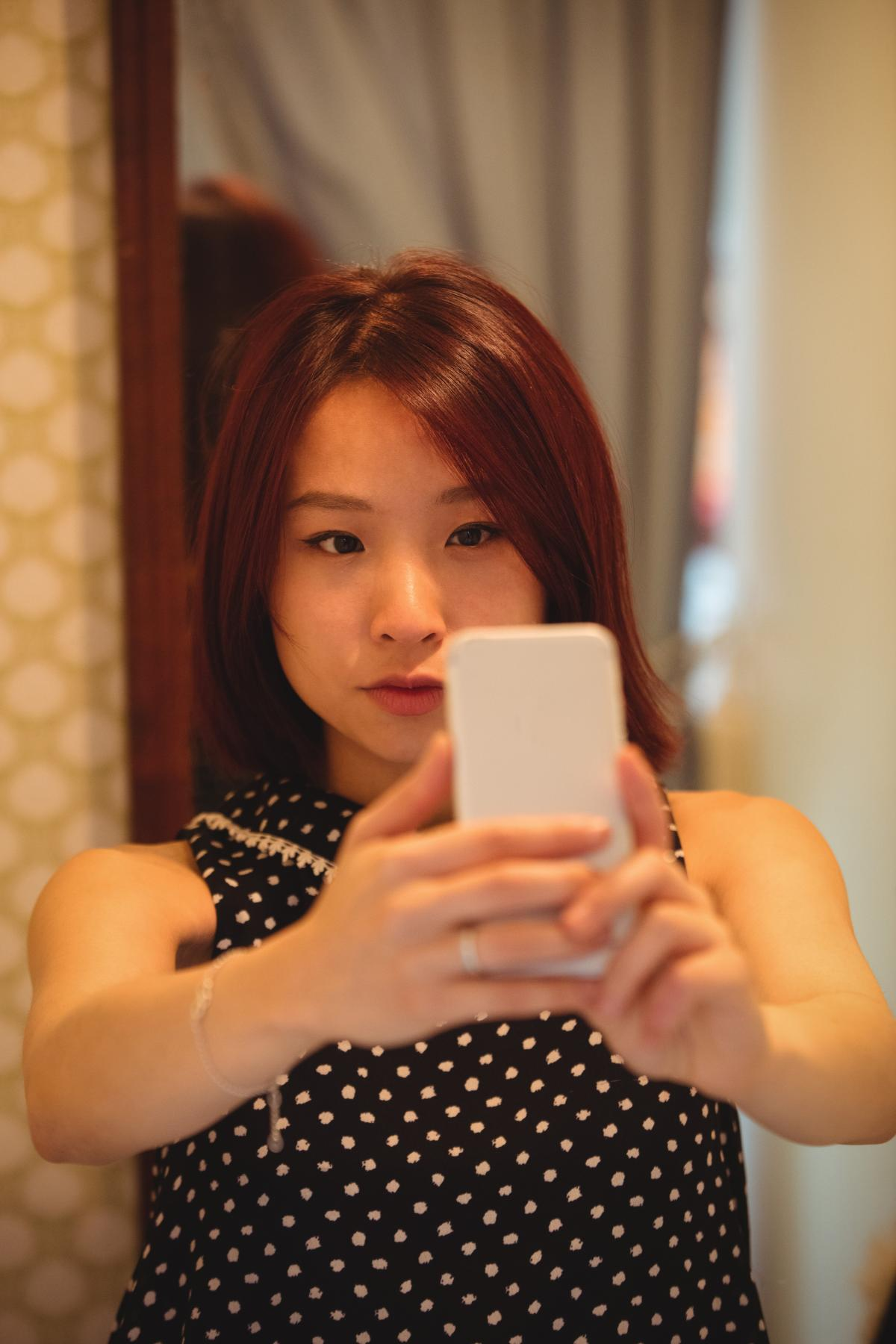 Woman taking selfie from mobile phone #409503