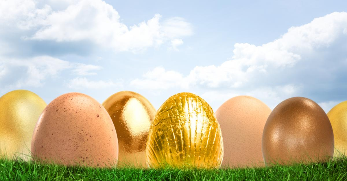 Gold Easter eggs in front of blue sky #409782