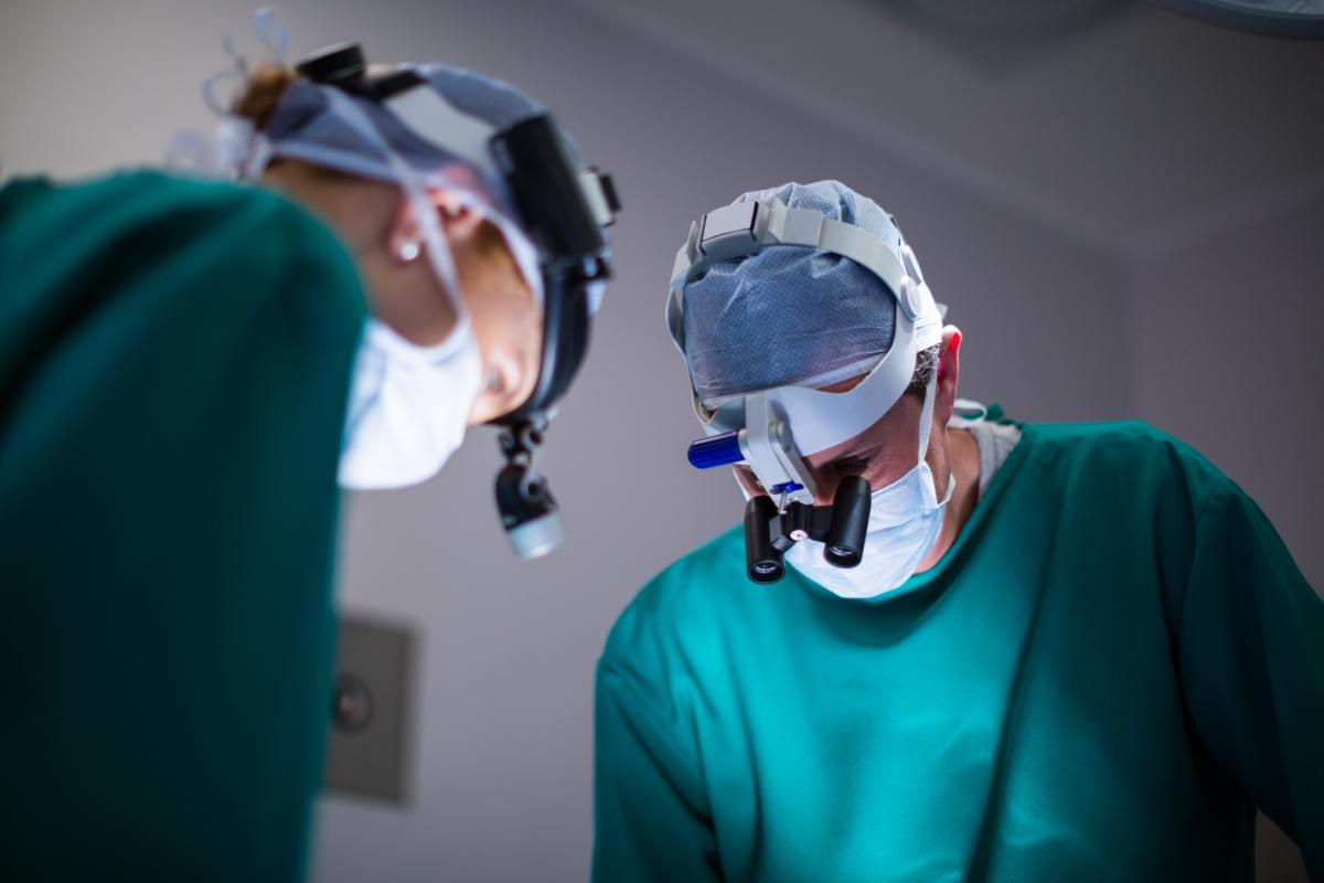 Surgeons wearing surgical loupes while performing operation #410839