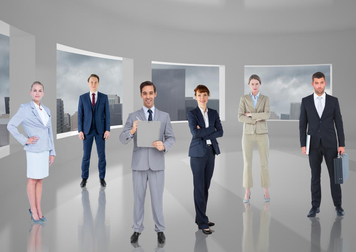 Business executives standing in room against cityscape background