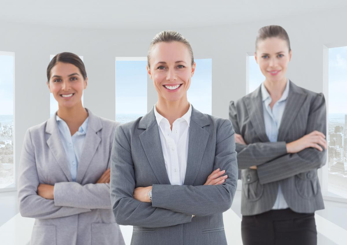 Female executives standing with arms crossed