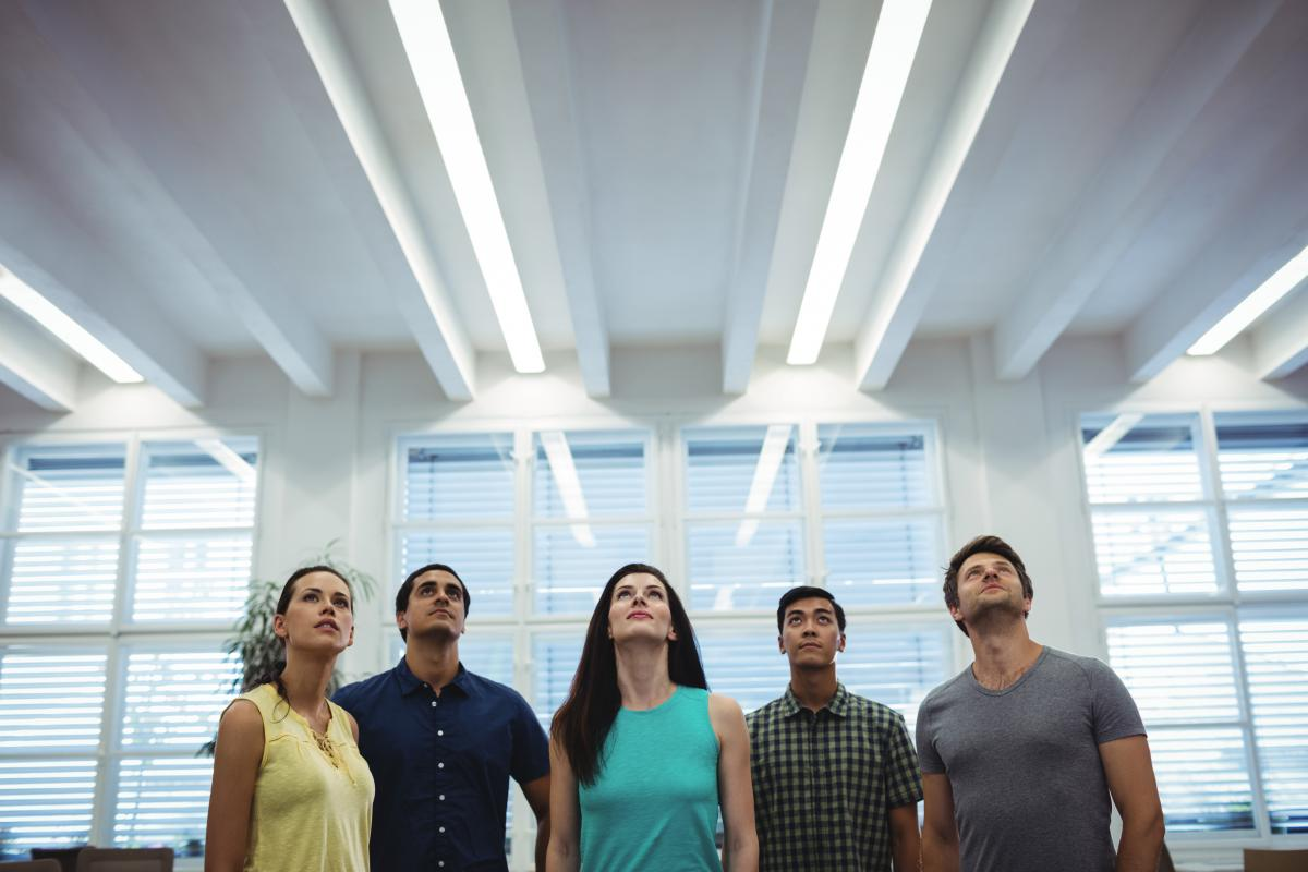 Group of business executives looking up