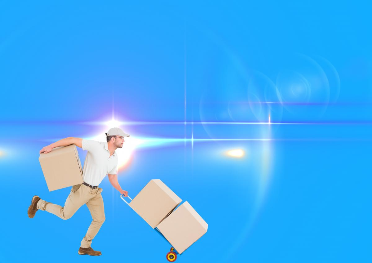 Delivery man with trolley of boxes running
