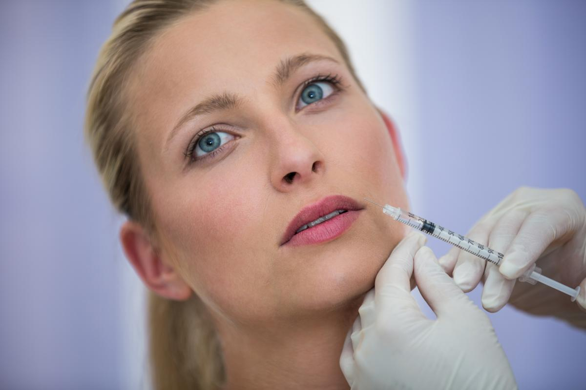 Female patient receiving a botox injection on face