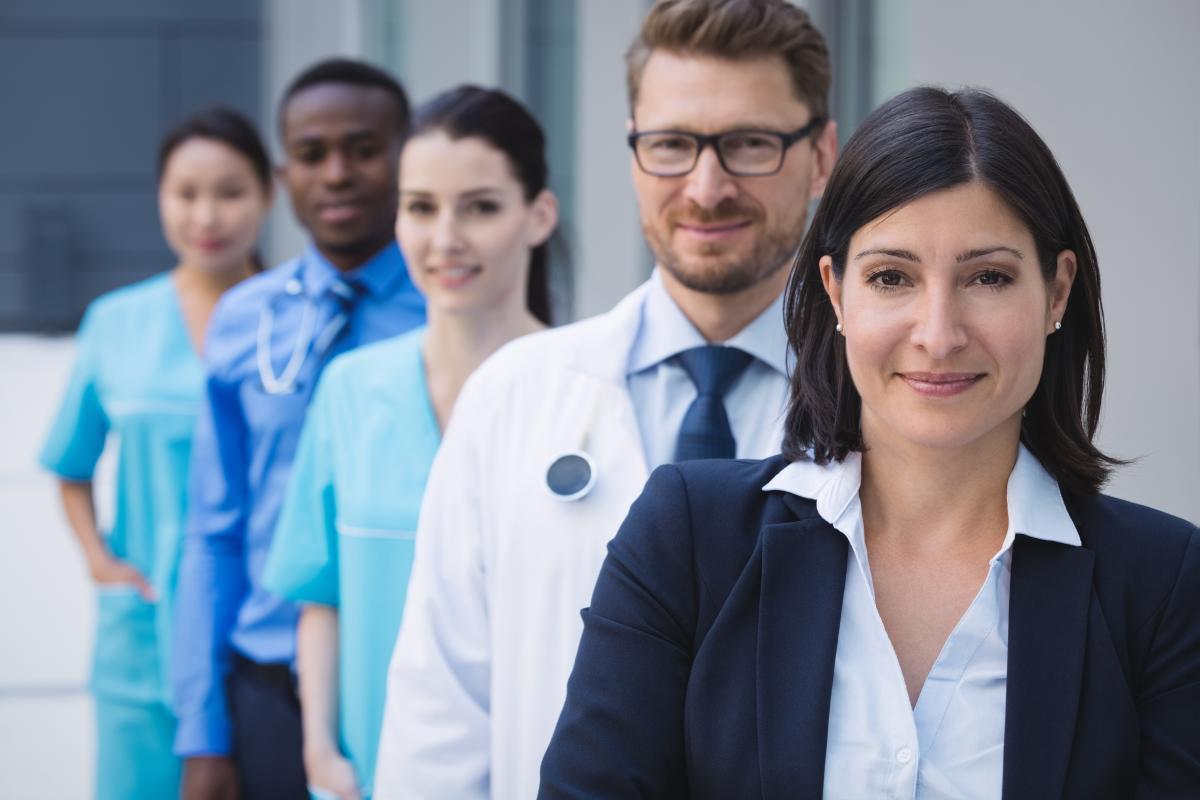 Team of doctors standing in row
