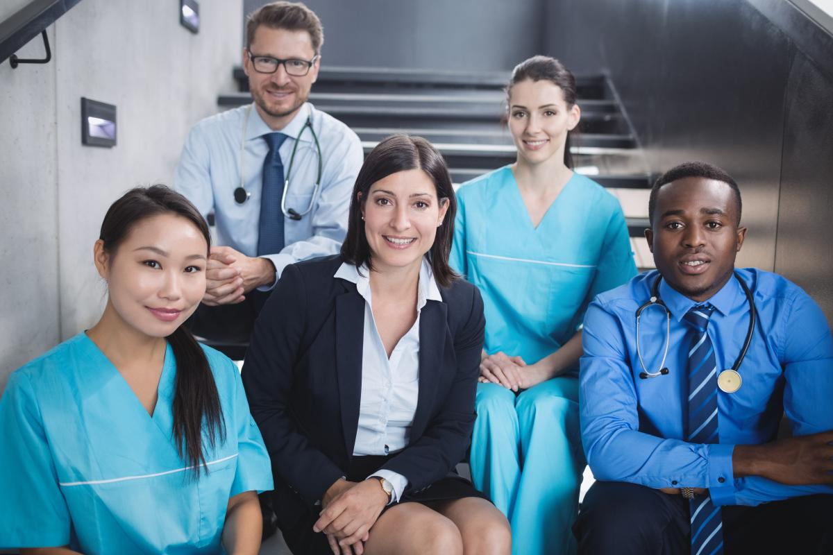 Doctors and nurses sitting on staircase