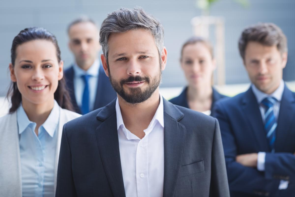 Confident businessman with colleagues