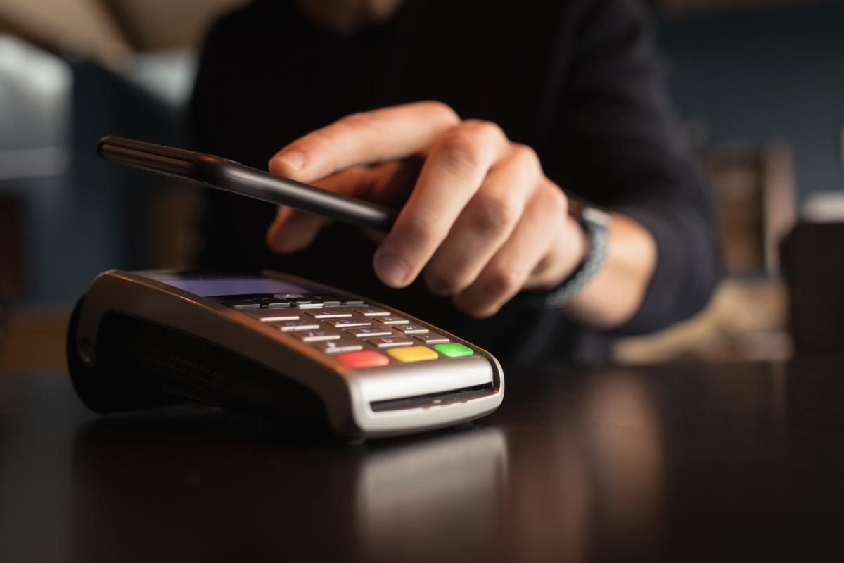 Man paying bill through smartphone using NFC technology #414826