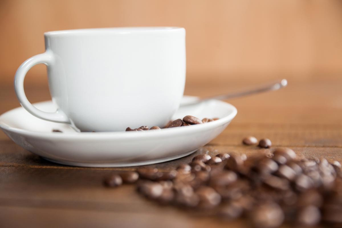 Cup of coffee with coffee beans and spoon #415408