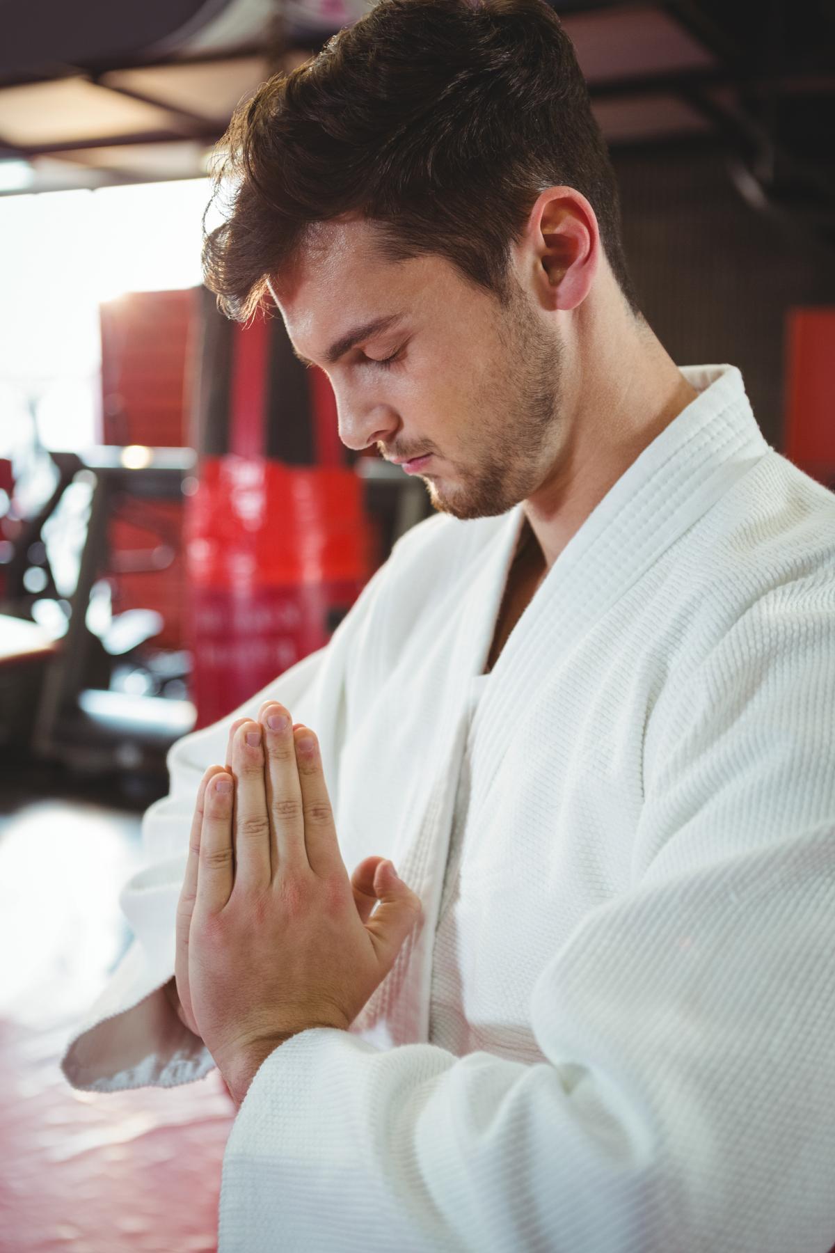 Karate player in prayer pose #416615