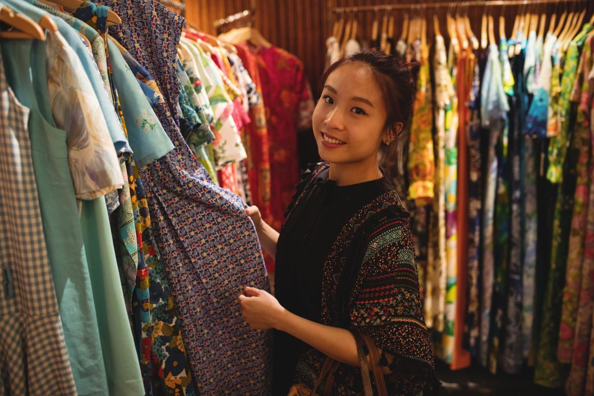 Portrait of smiling woman selecting a clothes