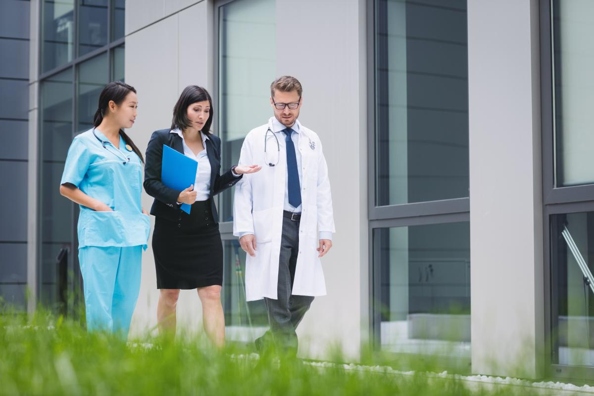 Doctors and nurse interacting while walking #418979