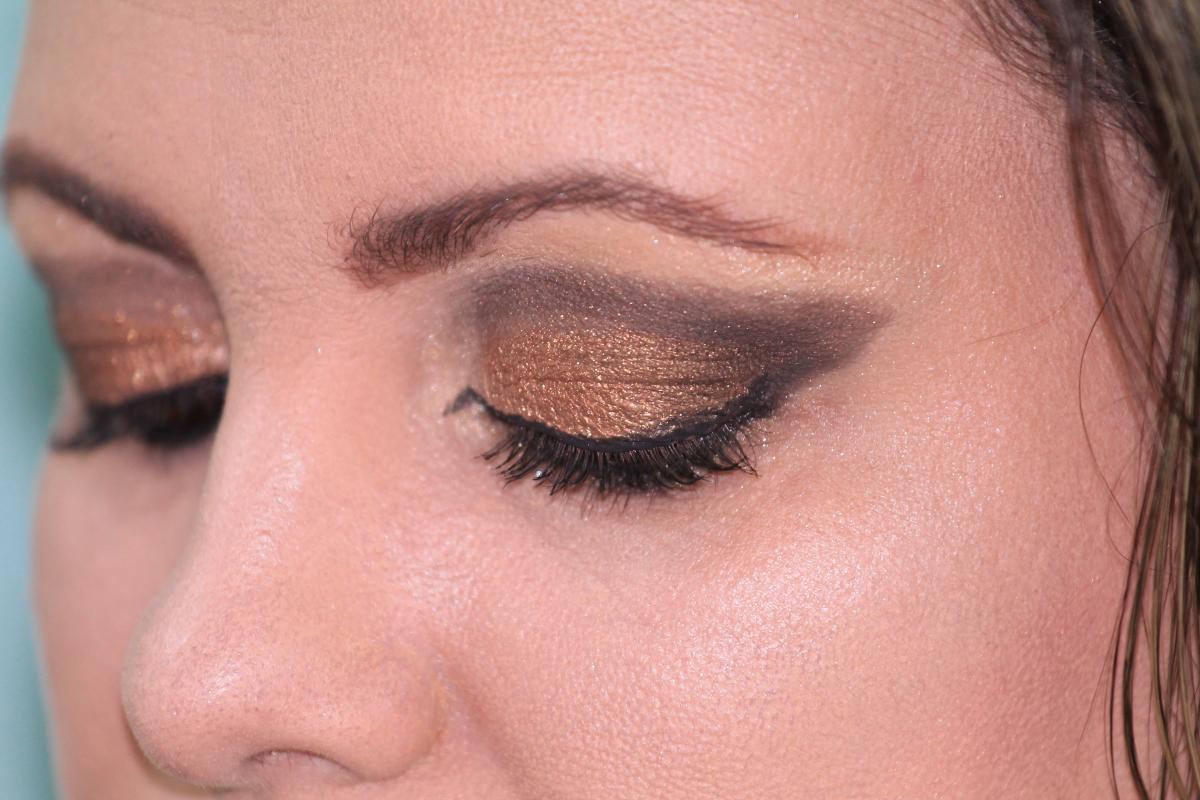 Woman makeup shadows gold