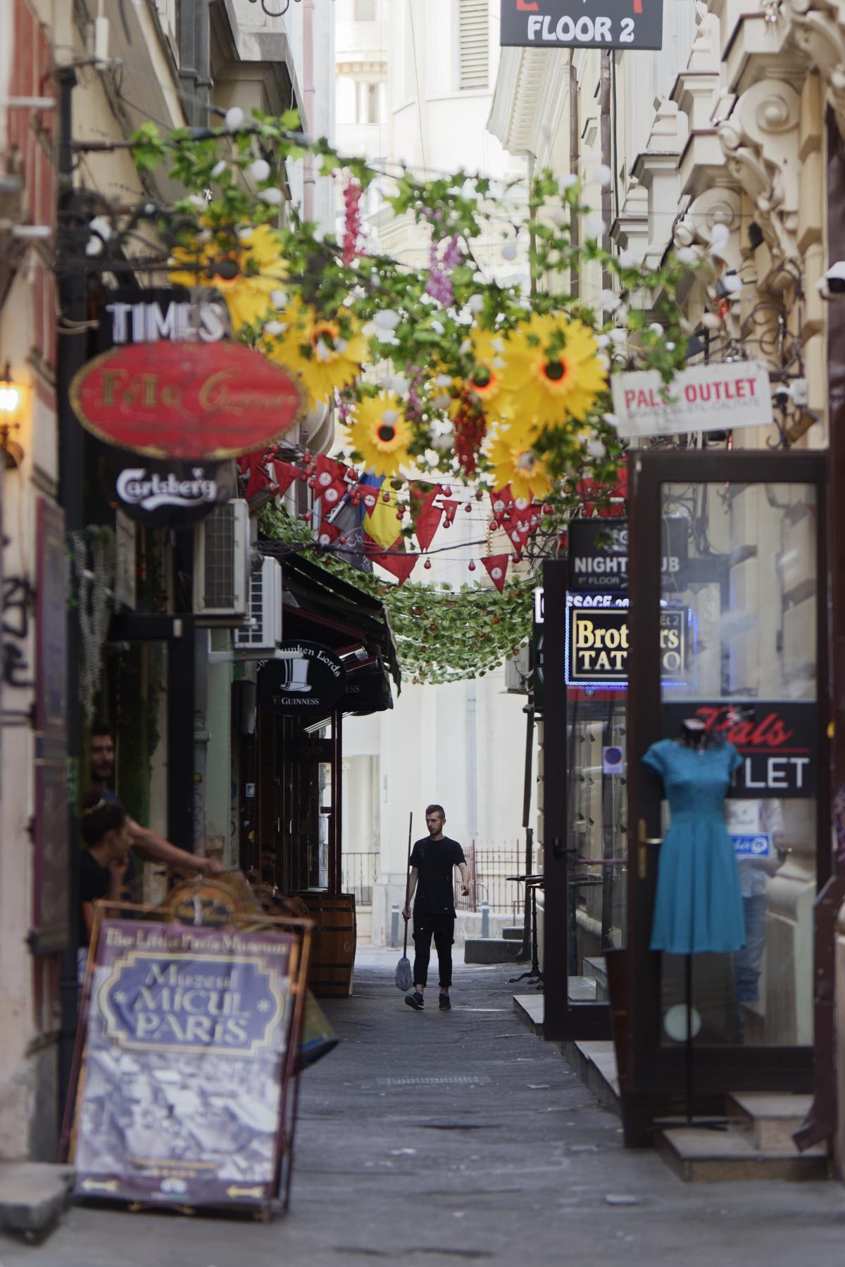 Man Walking Between the Alley