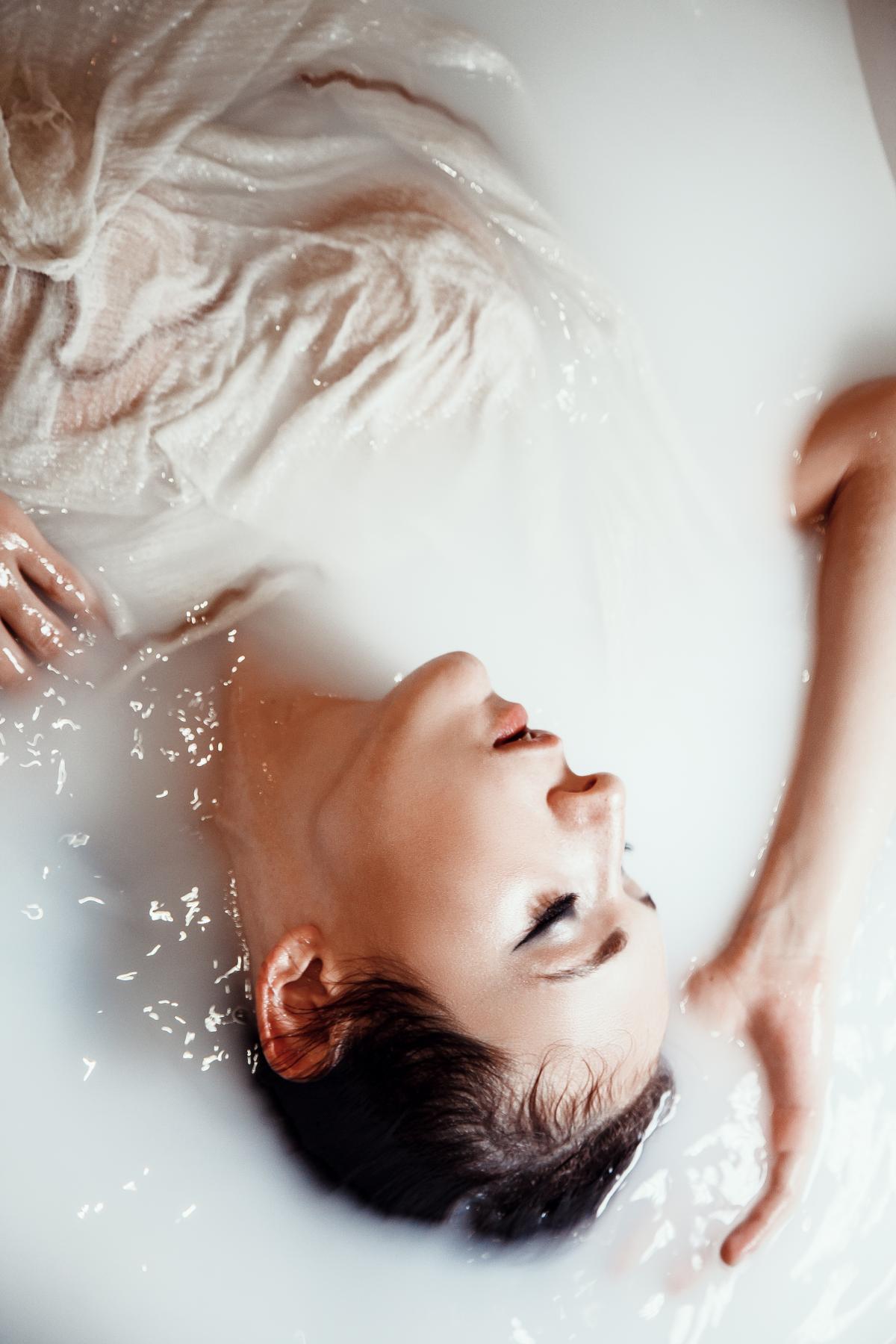 Woman Relaxing In A Tub Of Milk Bath #426376