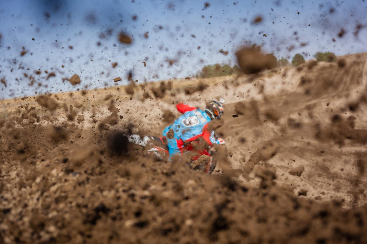 Person in Blue and Red Suit Riding Dirt Bike during Daytime #43355