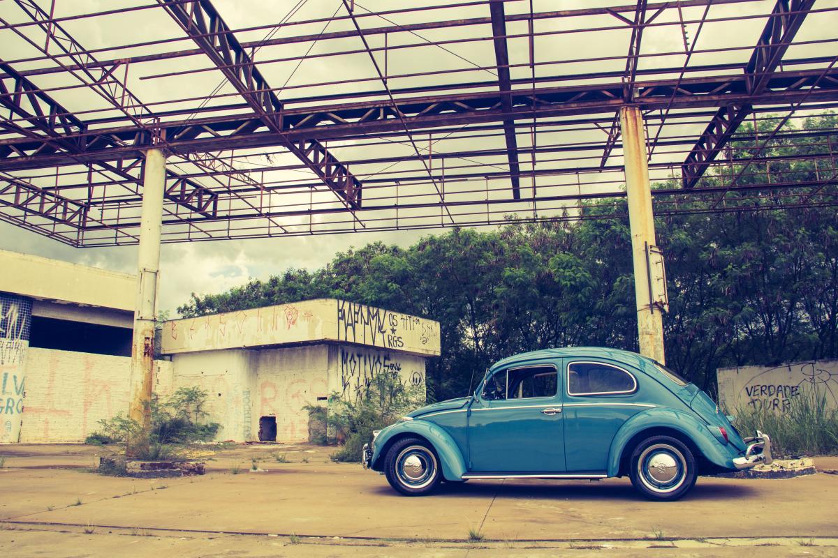Blue Volkswagen Beetle in Front of Building #44528
