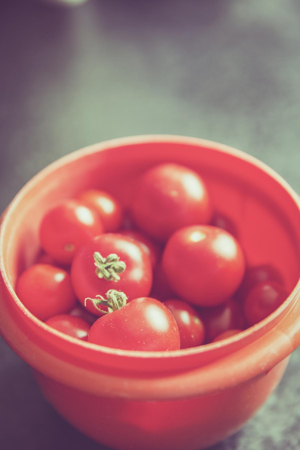 Red Tomato on Orange Round Plastic Container