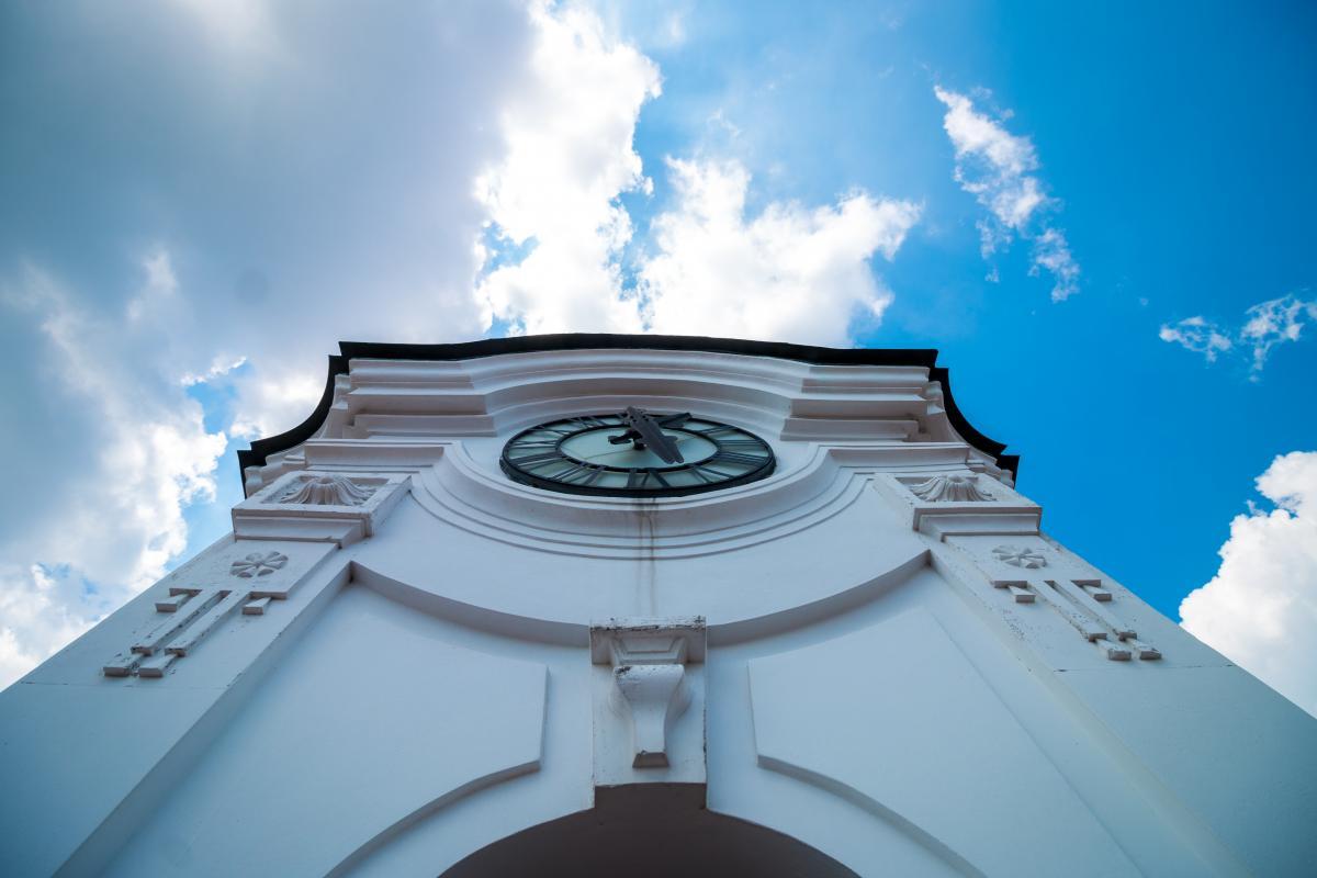 White Concrete Building With Clock Under Blue White Sky #47733