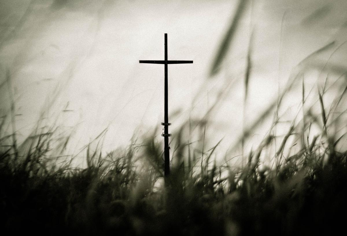 Cross on grass against sky #62017