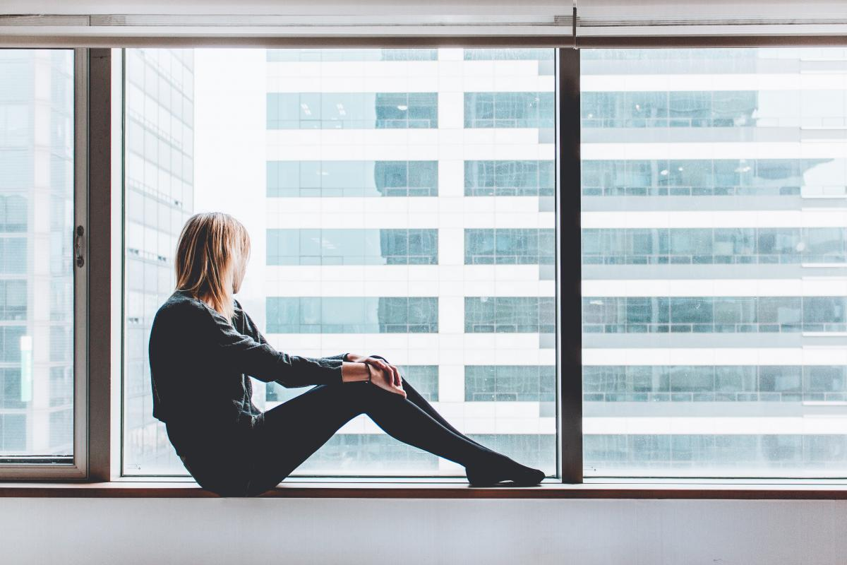 Woman Sitting on Window #63877