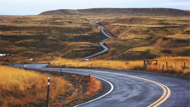 landscape winding road fields  Free Photo