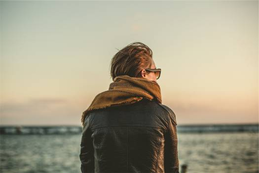 leather jacket scarf sunglasses  Free Photo