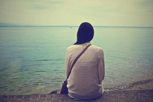 girl looking lake  Free Photo